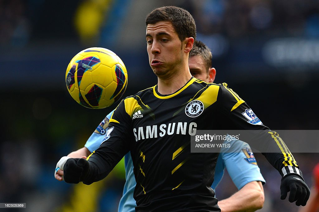 "Chelsea's Belgian midfielder Eden Hazard controls the ball during the English Premier League football match between Manchester City and Chelsea at the Etihad Stadium in Manchester, northwest England, on February 24, 2013. USE. No use with unauthorized audio, video, data, fixture lists, club/league logos or ""live"" services. Online in-match use limited to 45 images, no video emulation. No use in betting, games or single club/league/player publications."