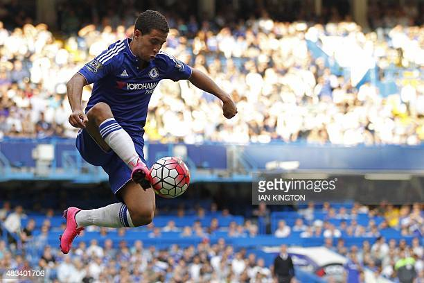 Chelsea's Belgian midfielder Eden Hazard controls the ball during the English Premier League football match between Chelsea and Swansea City at...