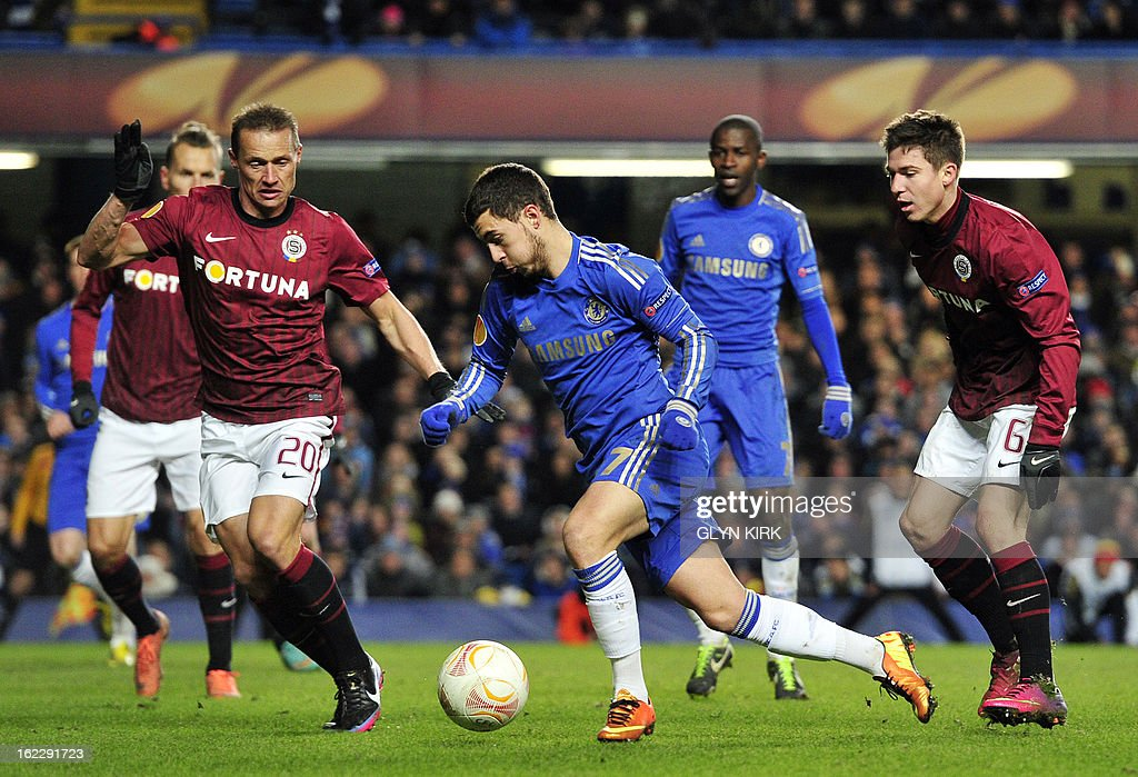 Chelsea's Belgian midfielder Eden Hazard (C) goes past Sparta Prague's Czech defender Tomas Zapotocny (L) on his way to scoring his late goal during the UEFA Europa League round of 32 football match between Chelsea and Sparta Prague in London on February 21, 2013. The game finished 1-1, Chelsea winning the tie 2-1. AFP PHOTO/GLYN KIRK