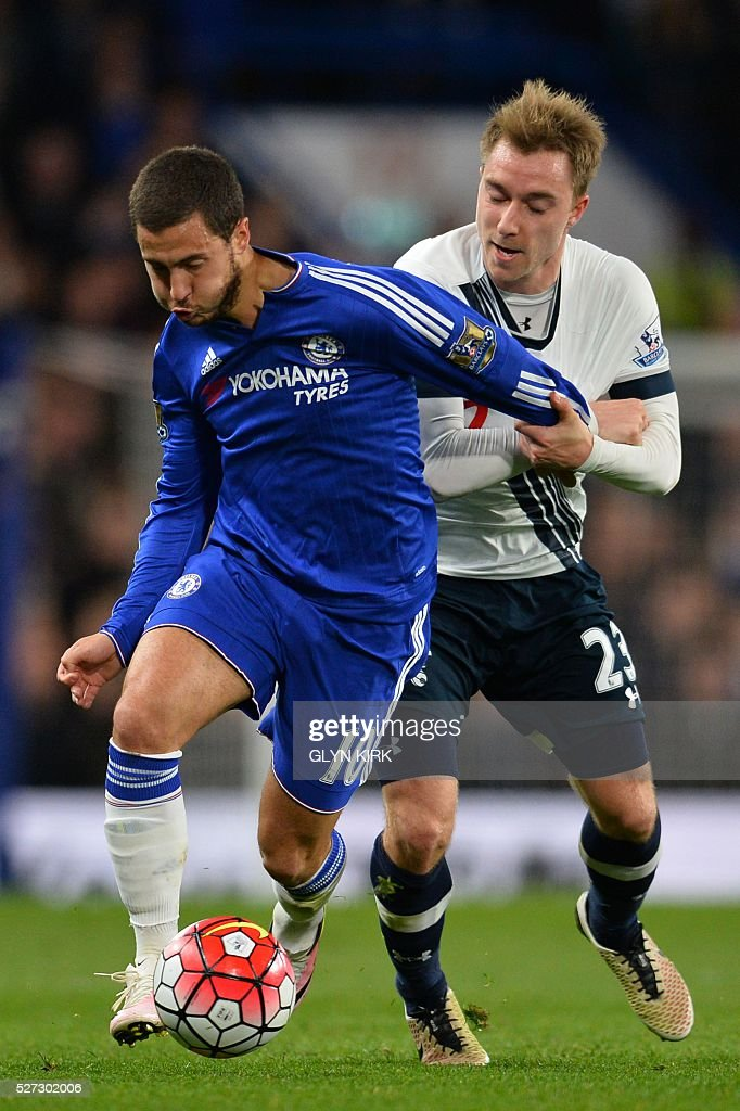 Chelsea's Belgian midfielder Eden Hazard (L) is fouled by Tottenham Hotspur's Danish midfielder Christian Eriksen (R) during the English Premier League football match between Chelsea and Tottenham Hotspur at Stamford Bridge in London on May 2, 2016. / AFP / GLYN KIRK / RESTRICTED TO EDITORIAL USE. No use with unauthorized audio, video, data, fixture lists, club/league logos or 'live' services. Online in-match use limited to 75 images, no video emulation. No use in betting, games or single club/league/player publications. /