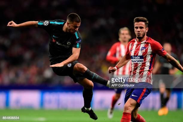 Chelsea's Belgian midfielder Eden Hazard kicks to score during the UEFA Champions League Group C football match Club Atletico de Madrid vs Chelsea FC...