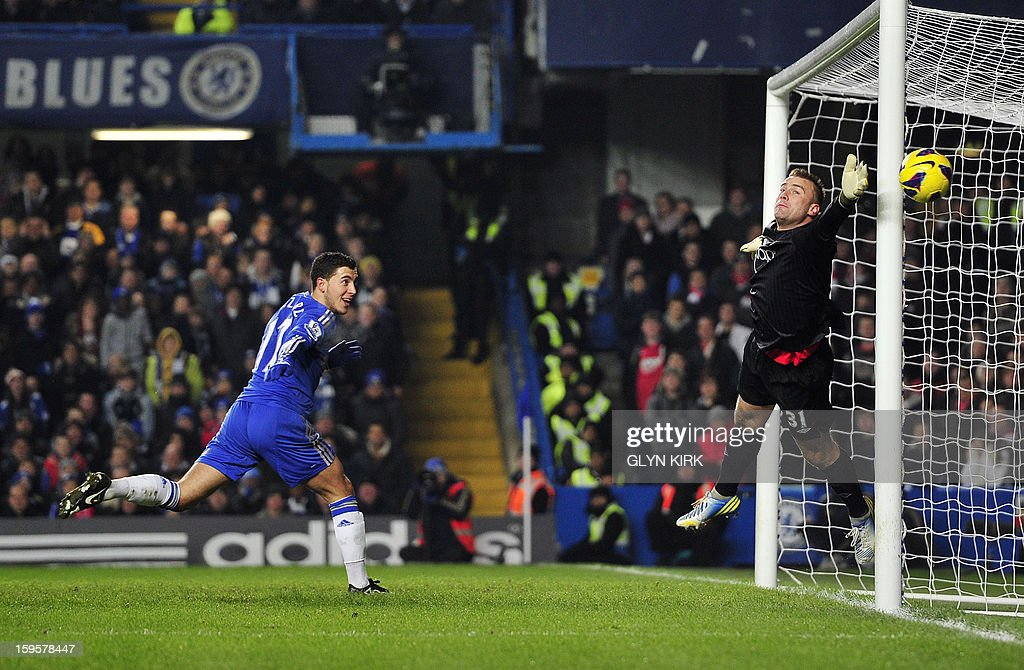 """Chelsea's Belgian midfielder Eden Hazard (L) misses a chance to score past Southampton's Polish goalkeeper Artur Boruc (R) during the English Premier League football match between Chelsea and Southampton at Stamford Bridge in London, on January 16, 2013. USE. No use with unauthorized audio, video, data, fixture lists, club/league logos or """"live"""" services. Online in-match use limited to 45 images, no video emulation. No use in betting, games or single club/league/player publications."""