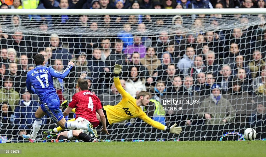 "Chelsea's Belgian midfielder Eden Hazard (L) misses an chance on goal during their English FA Cup quarter final replay football match against Manchester United at Stamford Bridge in London, England on April 1, 2013. Chelsea won 1-0. AFP PHOTO/GLYN KIRK RESTRICTED TO EDITORIAL USE. No use with unauthorized audio, video, data, fixture lists, club/league logos or ""live"" services. Online in-match use limited to 45 images, no video emulation. No use in betting, games or single club/league/player publications."