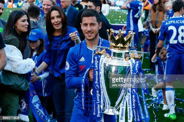 Chelsea's Belgian midfielder Eden Hazard raises the English Premier League trophy as players celebrate their league title win at the end of the...