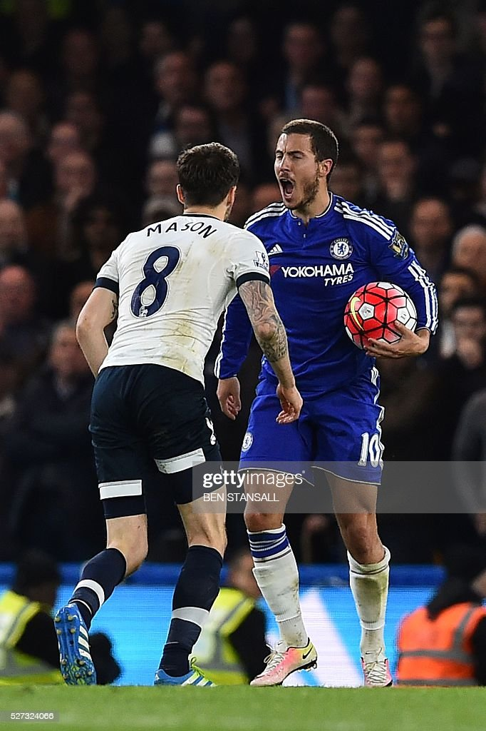 Chelsea's Belgian midfielder Eden Hazard (R) reacts after a foul during the English Premier League football match between Chelsea and Tottenham Hotspur at Stamford Bridge in London on May 2, 2016. / AFP / BEN STANSALL / RESTRICTED TO EDITORIAL USE. No use with unauthorized audio, video, data, fixture lists, club/league logos or 'live' services. Online in-match use limited to 75 images, no video emulation. No use in betting, games or single club/league/player publications. /