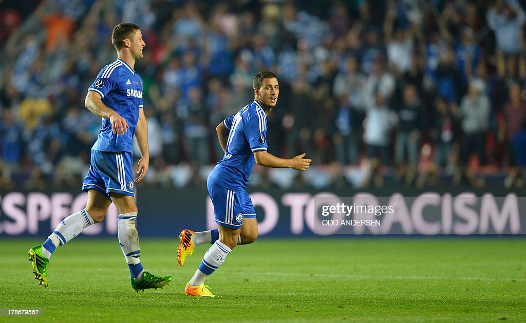 Chelsea's Belgian midfielder Eden Hazard (R) reacts after scoring during the UEFA Super Cup football match FC Bayern Munich vs Chelsea FC on August 30, 2013 at the Eden Stadium, in Prague.