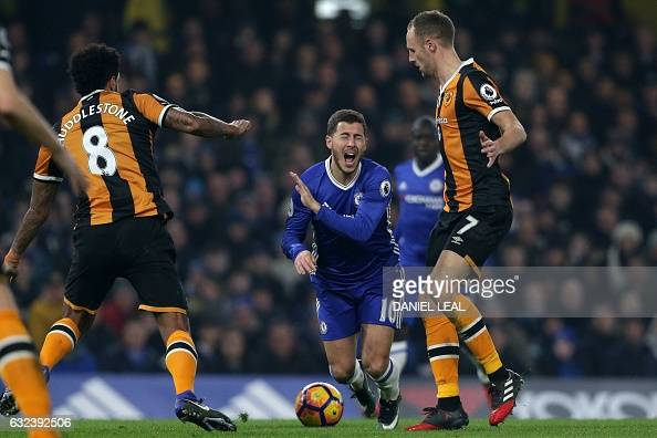 Chelsea's Belgian midfielder Eden Hazard reacts under a challenge during the English Premier League football match between Chelsea and Hull City at...