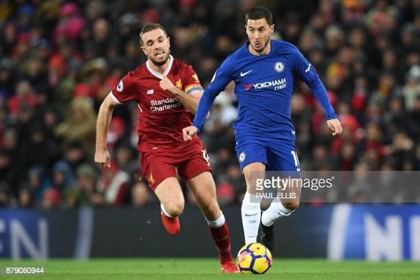 Chelsea's Belgian midfielder Eden Hazard runs away from Liverpool's English midfielder Jordan Henderson during the English Premier League football...