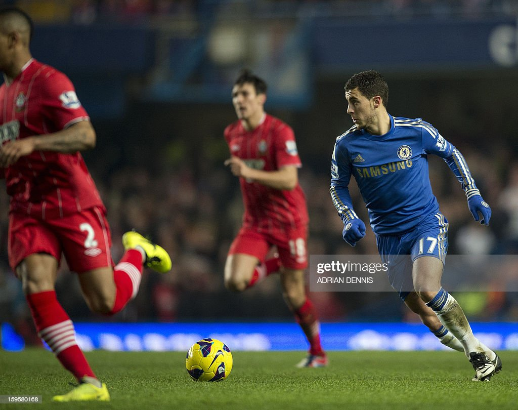 "Chelsea's Belgian midfielder Eden Hazard (R) runs with the ball during the English Premier League football match between Chelsea and Southampton at Stamford Bridge in London, on January 16, 2013. The game finished 2-2. USE. No use with unauthorized audio, video, data, fixture lists, club/league logos or ""live"" services. Online in-match use limited to 45 images, no video emulation. No use in betting, games or single club/league/player publications."