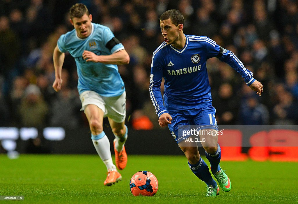 Chelsea's Belgian midfielder Eden Hazard (R) runs with the ball during the English FA Cup fifth round football match between Manchester City and Chelsea at The Etihad Stadium in Manchester, northwest England on February 15, 2014. USE. No use with unauthorized audio, video, data, fixture lists, club/league logos or live services. Online in-match use limited to 45 images, no video emulation. No use in betting, games or single club/league/player publications.