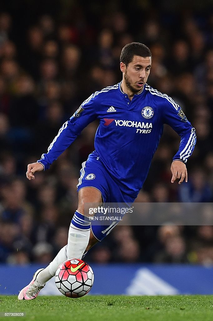 Chelsea's Belgian midfielder Eden Hazard runs with the ball during the English Premier League football match between Chelsea and Tottenham Hotspur at Stamford Bridge in London on May 2, 2016. / AFP / BEN STANSALL / RESTRICTED TO EDITORIAL USE. No use with unauthorized audio, video, data, fixture lists, club/league logos or 'live' services. Online in-match use limited to 75 images, no video emulation. No use in betting, games or single club/league/player publications. /