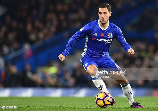 Chelsea's Belgian midfielder Eden Hazard runs with the ball during the English Premier League football match between Chelsea and Everton at Stamford...