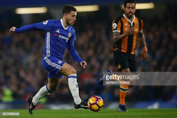 Chelsea's Belgian midfielder Eden Hazard runs with the ball during the English Premier League football match between Chelsea and Hull City at...