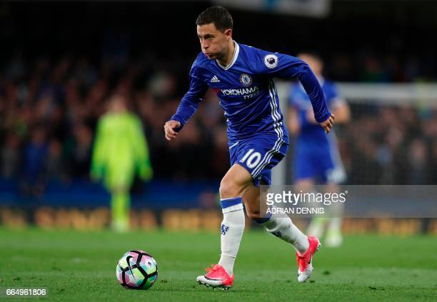 Chelsea's Belgian midfielder Eden Hazard runs with the ball during the English Premier League football match between Chelsea and Manchester City at...
