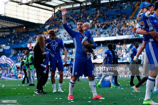 Chelsea's Belgian midfielder Eden Hazard salutes the crowd at the end of the presentation ceremony for the English Premier League trophy at the end...