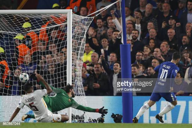 Chelsea's Belgian midfielder Eden Hazard scores past Roma's Brazilian goalkeeper Alisson to make it 20 during a UEFA Champions league group stage...