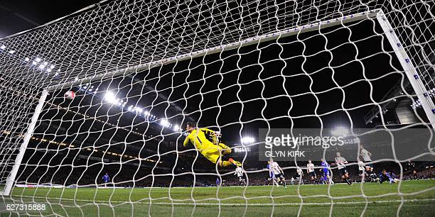 TOPSHOT Chelsea's Belgian midfielder Eden Hazard scores their second goal to level the score at 22 during the English Premier League football match...