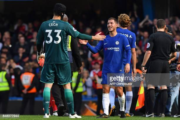 Chelsea's Belgian midfielder Eden Hazard shakes hands with Arsenal's Czech goalkeeper Petr Cech on the pitch after the English Premier League...