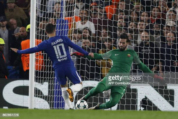 Chelsea's Belgian midfielder Eden Hazard shoots and is blocked by Roma's Brazilian goalkeeper Alisson during a UEFA Champions league group stage...