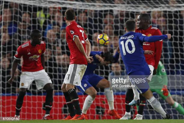 Chelsea's Belgian midfielder Eden Hazard shoots but fails to score during the English Premier League football match between Chelsea and Manchester...
