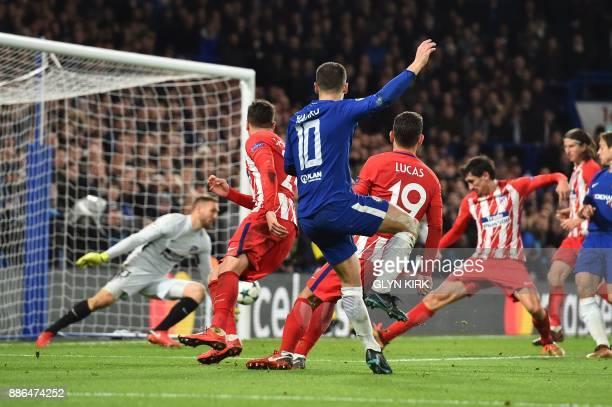TOPSHOT Chelsea's Belgian midfielder Eden Hazard shoots goalward and Atletico Madrid's Montenegrin defender Stefan Savic blocks to score an own goal...