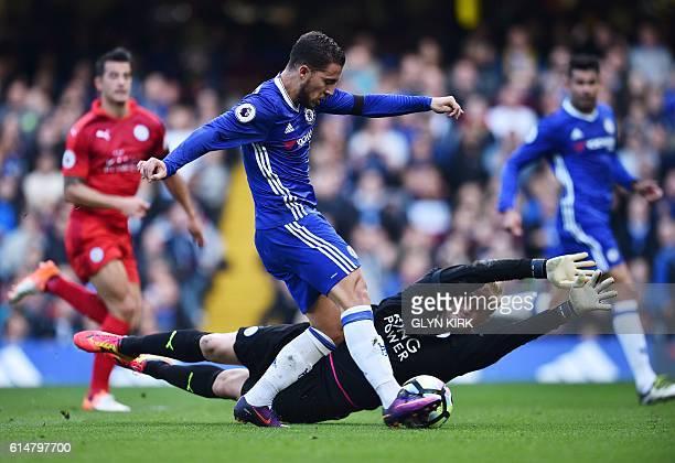 Chelsea's Belgian midfielder Eden Hazard shoots past Leicester City's Danish goalkeeper Kasper Schmeichel to score Chelsea's second goal during the...