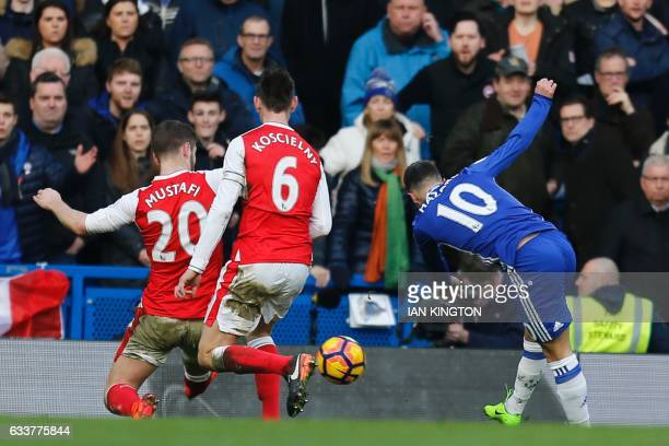 Chelsea's Belgian midfielder Eden Hazard shoots to scores their second goal during the English Premier League football match between Chelsea and...