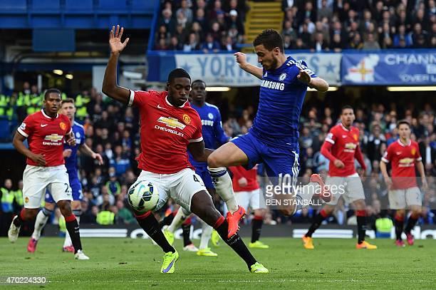 Chelsea's Belgian midfielder Eden Hazard tries to get past Manchester United's English defender Tyler Blackett during the English Premier League...