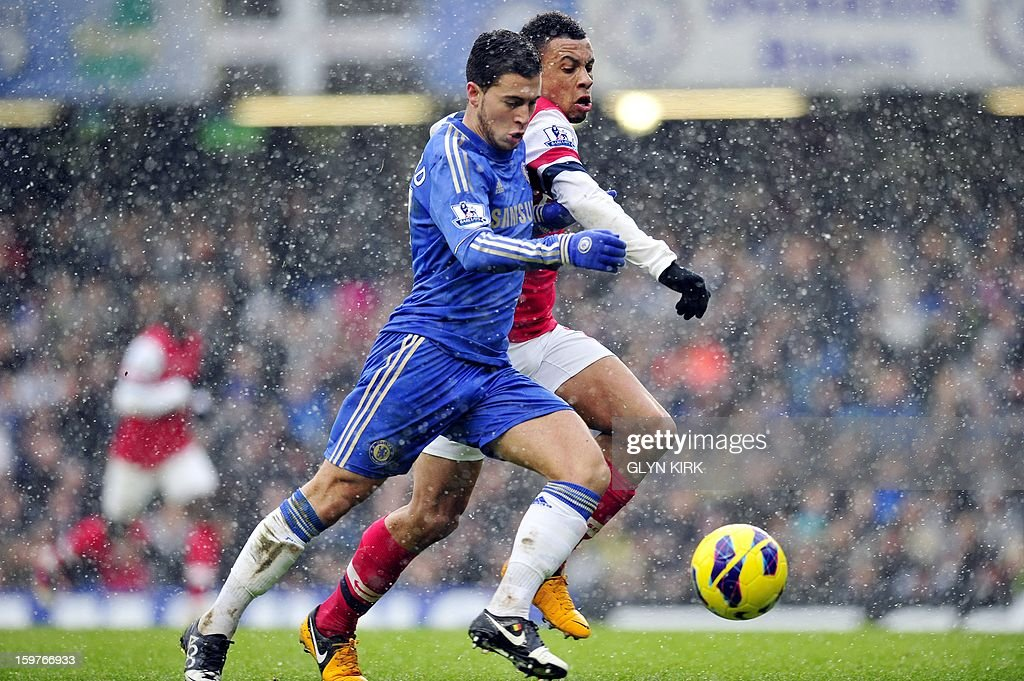 "Chelsea's Belgian midfielder Eden Hazard (L) vies with Arsenal's French midfielder Francis Coquelin (R) during their English Premier League football match at Stamford Bridge in London, England on January 20, 2013. AFP PHOTO/Glyn KIRK - RESTRICTED TO EDITORIAL USE. No use with unauthorized audio, video, data, fixture lists, club/league logos or ""live"" services. Online in-match use limited to 45 images, no video emulation. No use in betting, games or single club/league/player publications."