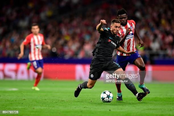 Chelsea's Belgian midfielder Eden Hazard vies with Atletico Madrid's Ghanaian midfielder Thomas during the UEFA Champions League Group C football...