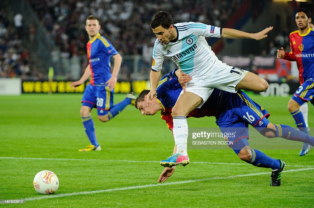Chelsea's Belgian midfielder Eden Hazard (R) vies with Basel's Swiss defender Fabian Schar (C) during an UEFA Europa League first leg semi-final football match between Basel and Chelsea at the St Jakob stadium in Basel on April 25, 2013.