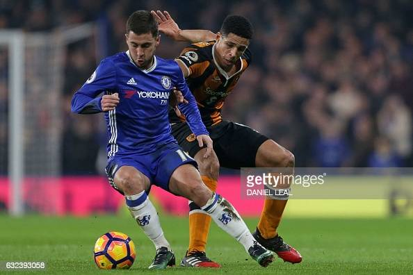 Chelsea's Belgian midfielder Eden Hazard vies with Hull City's English defender Curtis Davies during the English Premier League football match...