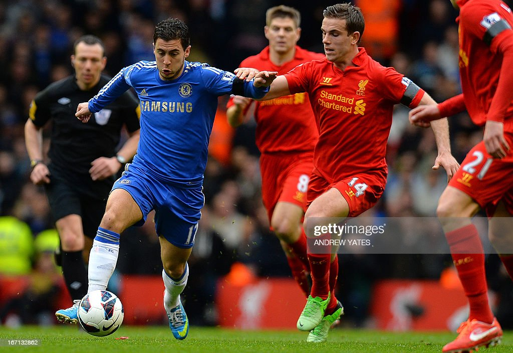 "Chelsea's Belgian midfielder Eden Hazard (L) vies with Liverpool's English midfielder Jordan Henderson (R) during the English Premier League football match between Liverpool and Chelsea at the Anfield stadium in Liverpool, northwest England, on April 21, 2013. USE. No use with unauthorized audio, video, data, fixture lists, club/league logos or ""live"" services. Online in-match use limited to 45 images, no video emulation. No use in betting, games or single club/league/player publications."