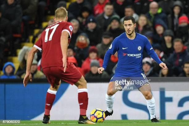 Chelsea's Belgian midfielder Eden Hazard vies with Liverpool's Estonian defender Ragnar Klavan during the English Premier League football match...