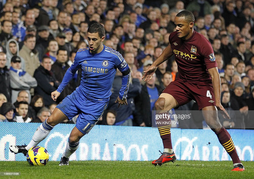 "Chelsea's Belgian midfielder Eden Hazard (L) vies with Manchester City's Belgian defender Vincent Kompany during the English Premier League football match between Chelsea and Manchester City at Stamford Bridge in London on November 25, 2012. USE. No use with unauthorized audio, video, data, fixture lists, club/league logos or ""live"" services. Online in-match use limited to 45 images, no video emulation. No use in betting, games or single club/league/player publications"