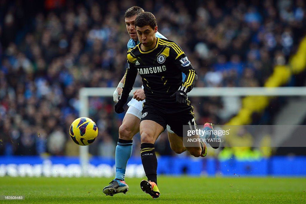 "Chelsea's Belgian midfielder Eden Hazard (R) vies with Manchester City's English midfielder James Milner (L) during the English Premier League football match between Manchester City and Chelsea at the Etihad Stadium in Manchester, northwest England, on February 24, 2013. AFP PHOTO/ANDREW YATES USE. No use with unauthorized audio, video, data, fixture lists, club/league logos or ""live"" services. Online in-match use limited to 45 images, no video emulation. No use in betting, games or single club/league/player publications."