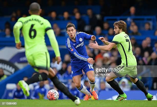Chelsea's Belgian midfielder Eden Hazard vies with Manchester City's Spanish midfielder Aleix Garcia Serrano and Manchester City's Brazilian...