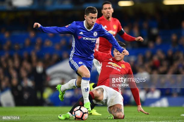 Chelsea's Belgian midfielder Eden Hazard vies with Manchester United's Argentinian defender Marcos Rojo during the English FA Cup quarter final...