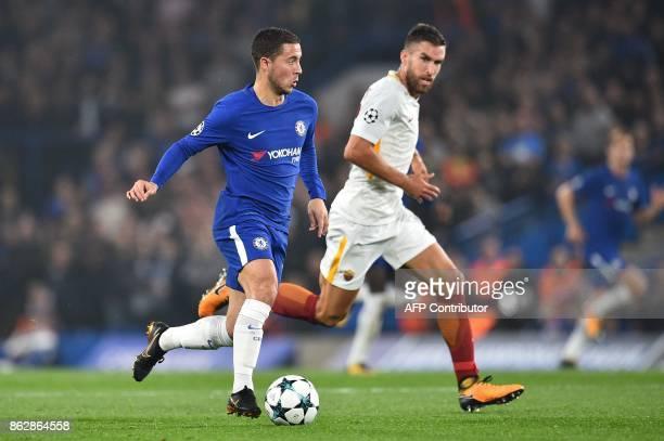 Chelsea's Belgian midfielder Eden Hazard vies with Roma's Dutch midfielder Kevin Strootman during a UEFA Champions league group stage football match...