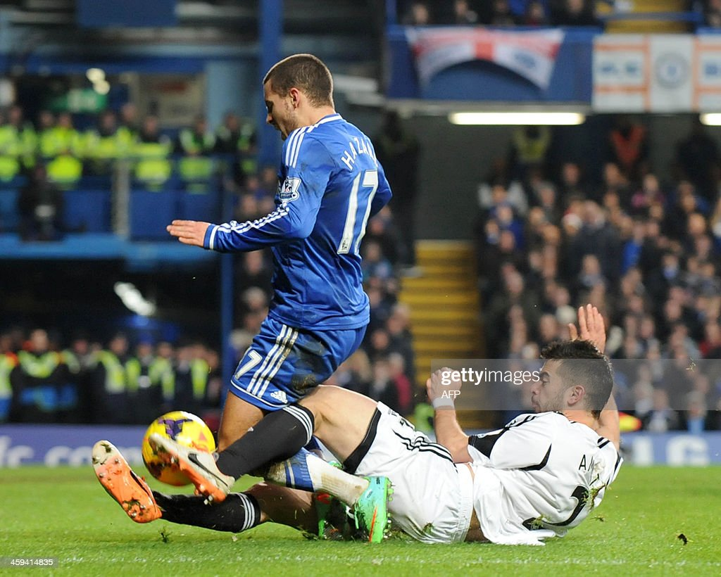 Chelsea's Belgian midfielder Eden Hazard (L) vies with Swansea City's Spanish defender Jordi Amat during the English Premier League football match between Chelsea and Swansea City at Stamford Bridge in London on December 26, 2013. Chelsea won the game 1-0. AFP PHOTO / OLLY GREENWOOD USE. No use with unauthorized audio, video, data, fixture lists, club/league logos or live services. Online in-match use limited to 45 images, no video emulation. No use in betting, games or single club/league/player publications.