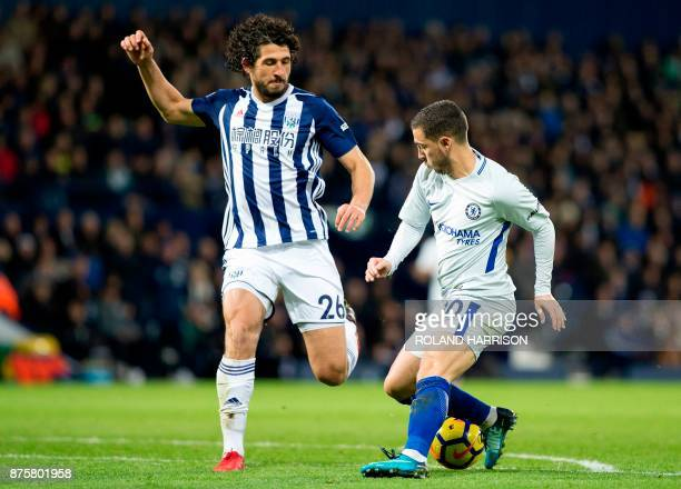 Chelsea's Belgian midfielder Eden Hazard vies with West Bromwich Albion's Egyptian defender Ahmed Hegazy during the English Premier League football...