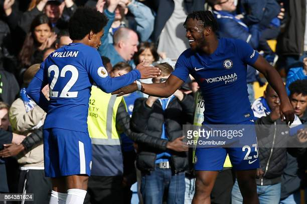 Chelsea's Belgian striker Michy Batshuayi celebrates his second and the team's fourth goal during the English Premier League football match between...