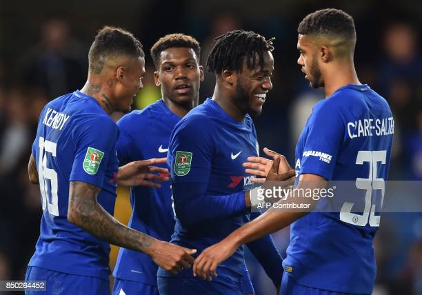 Chelsea's Belgian striker Michy Batshuayi celebrates scoring his third and his team's fifth goal during the English League Cup third round football...