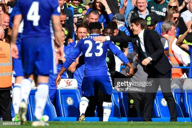 Chelsea's Belgian striker Michy Batshuayi celebrates scoring with Chelsea's Italian head coach Antonio Conte during the English Premier League...