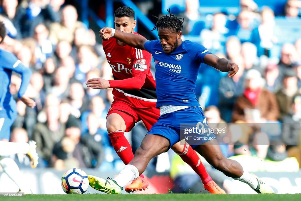 TOPSHOT - Chelsea's Belgian striker Michy Batshuayi (R) controls the ball during the English Premier League football match between Chelsea and Watford at Stamford Bridge in London on October 21, 2017. Chelsea won the match 4-2. / AFP PHOTO / Ian KINGTON / RESTRICTED TO EDITORIAL USE. No use with unauthorized audio, video, data, fixture lists, club/league logos or 'live' services. Online in-match use limited to 75 images, no video emulation. No use in betting, games or single club/league/player publications. /