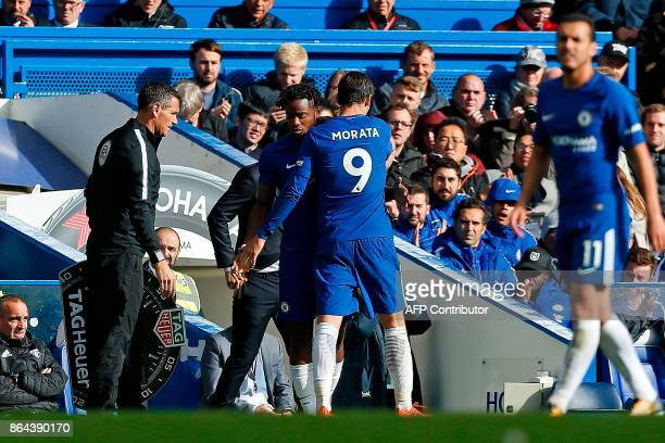 Chelsea's Belgian striker Michy Batshuayi is substituted on to the pitch for Chelsea's Spanish striker Alvaro Morata during the English Premier...