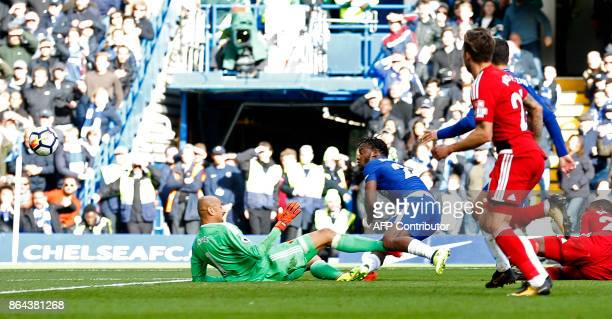 Chelsea's Belgian striker Michy Batshuayi scores his second and the team's fourth goal during the English Premier League football match between...
