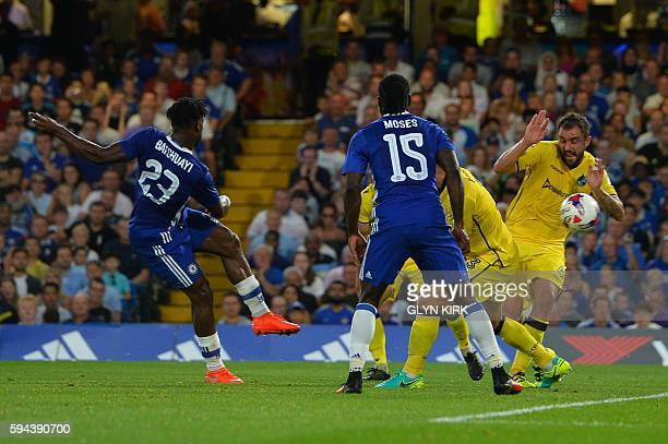 Chelsea's Belgian striker Michy Batshuayi scores the opening goal during the English League Cup second round football match between Chelsea and...