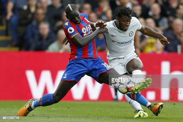 Chelsea's Belgian striker Michy Batshuayi shoots past Crystal Palace's French midfielder Mamadou Sakho during the English Premier League football...