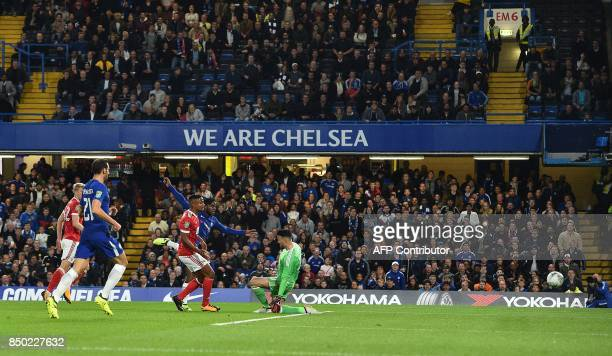 Chelsea's Belgian striker Michy Batshuayi shoots past Nottingham Forest's Irish goalkeeper Stephen Henderson to scores his team's second goal during...